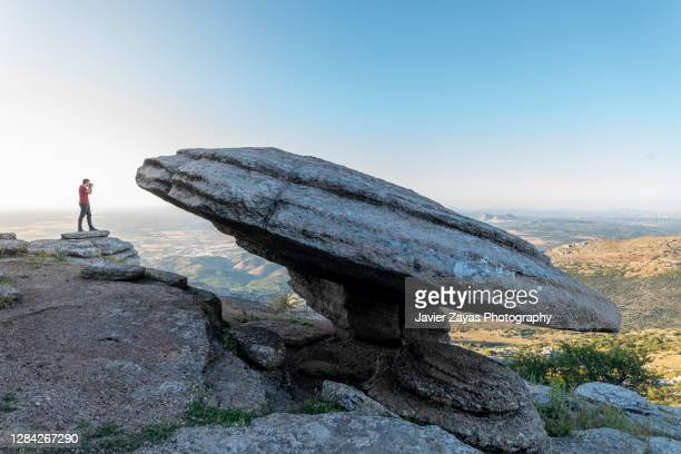 man taking pictures in el torcal de antequera mountain range - spain stock pictures, royalty-free photos & images
