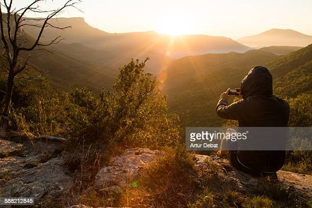 man taking pictures of the landscape on sunrise - nomadic people stock pictures, royalty-free photos & images