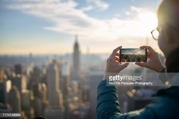 man taking pictures - nico de pasquale photography stock pictures, royalty-free photos & images