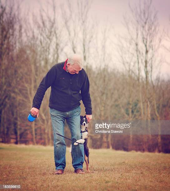Man taking puppy for a walk
