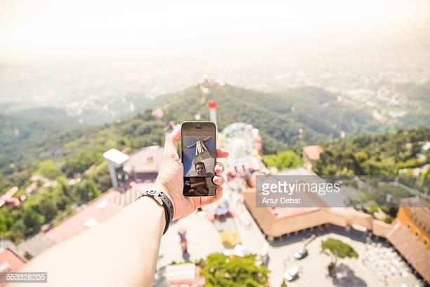 Man taking selfie from top of Tibidabo church.