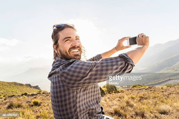 Man taking selfie on sunny day, Franschhoek, South Africa