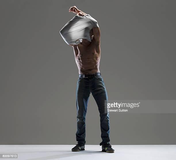 man taking shirt off