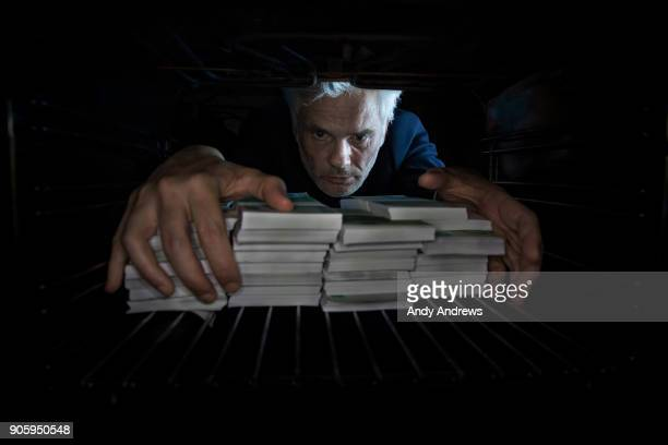 POV Man taking stacks of money out of hiding place