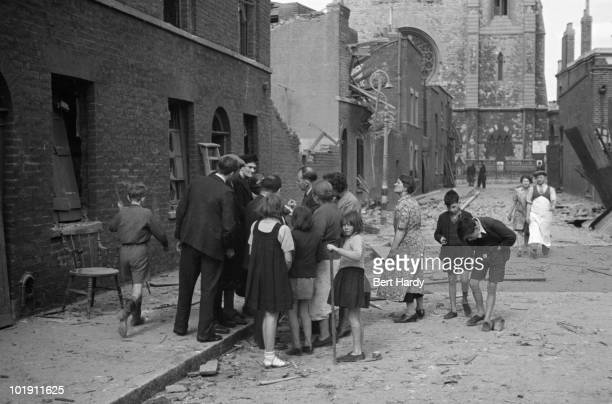 A man taking statements from bombed out residents in the east end of London during the Blitz September 1940 Original Publication Picture Post 297...