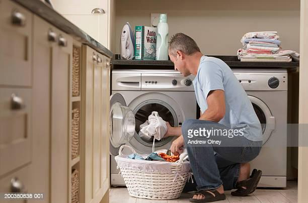 Man taking washing out of washing machine