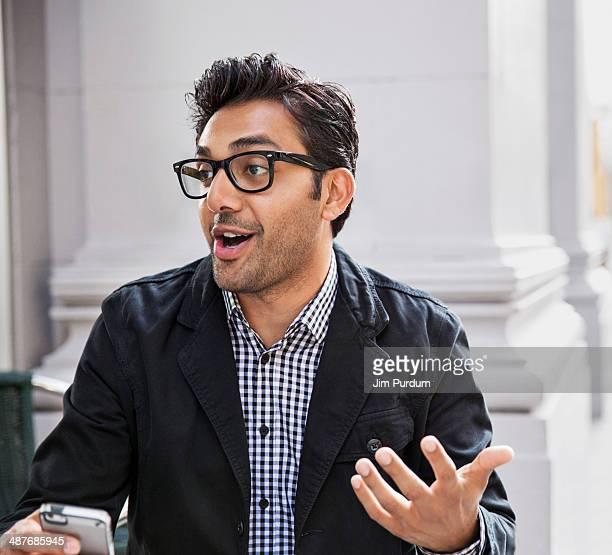 man talking at sidewalk cafe - explaining stock pictures, royalty-free photos & images