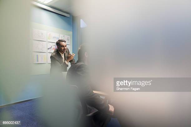 Man talking in design office meeting room