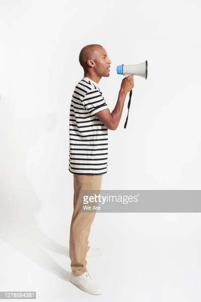 man talking into a megaphone - discussion stock pictures, royalty-free photos & images