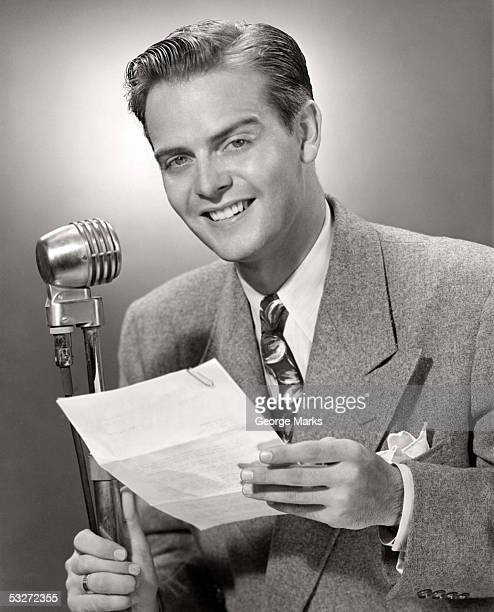 Man talking into microphone