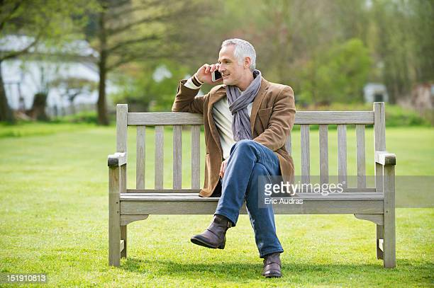 Man talking on a mobile phone in a park