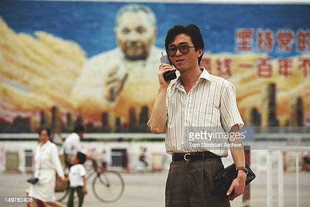 A man talking on a mobile telephone in Shenzhen China 1993