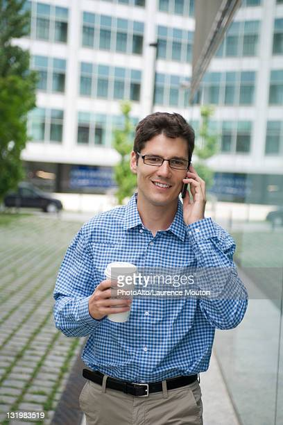 Man talking on cell phone in city
