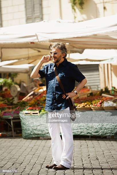 Man talking on cell phone in open-air market