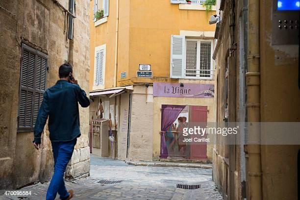 Man talking on mobile phone in Aix-en-Provence, France
