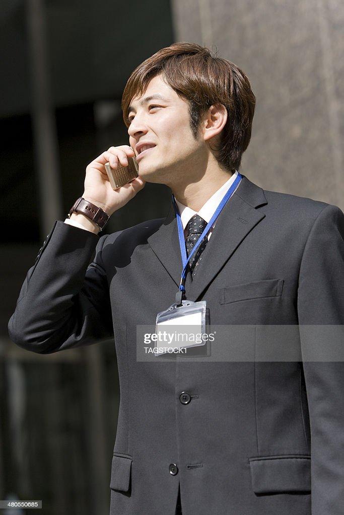 Man talking on mobile phone : Stock Photo