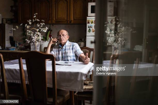 Man talking on phone from his living room
