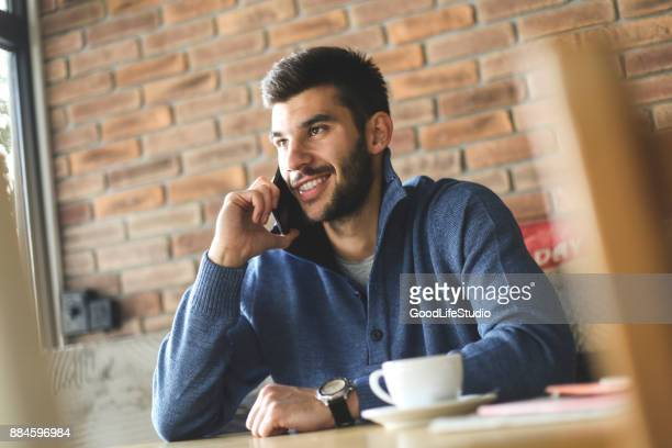 man talking on phone - only young men stock pictures, royalty-free photos & images