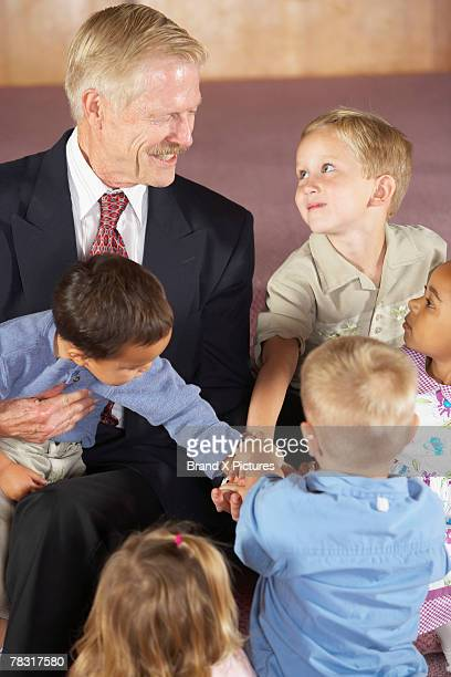 man talking to children - pastor stock pictures, royalty-free photos & images