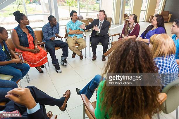Man talking to diverse group of people during therapy session