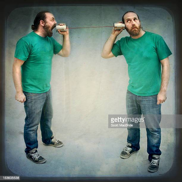 man talking to himself - scott macbride stock pictures, royalty-free photos & images