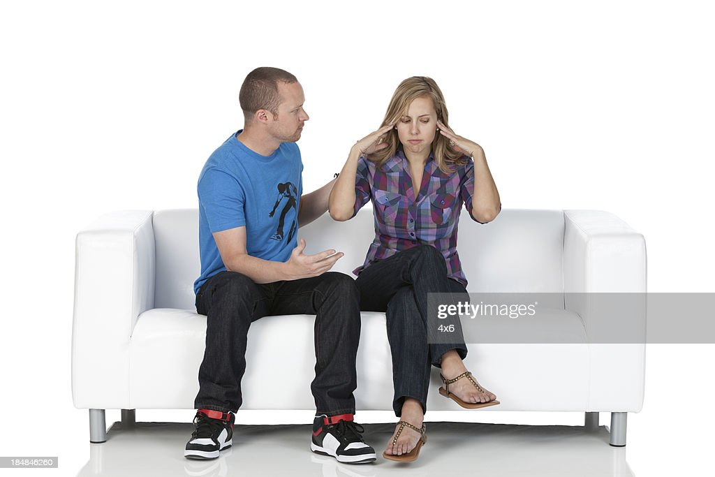Man talking to his wife suffering from headache : Stock Photo