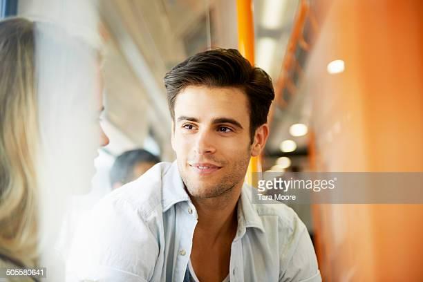 man talking to woman on train