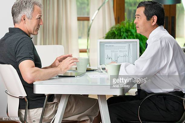 Man talking with financial advisor at table