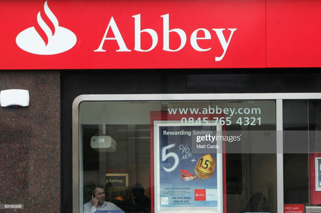 A man talks into his mobile phone inside a branch of Abbey on October 7, 2008 in Bristol, England. Financial markets continue to fluctuate as the banking crisis continues.