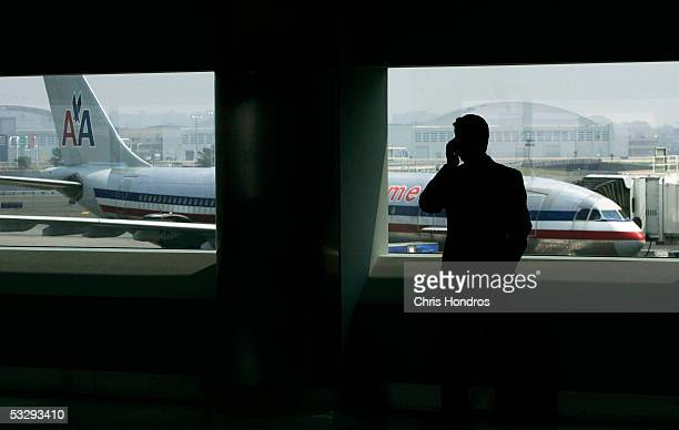 A man talks on a cell phone in the new American Airlines terminal at John F Kennedy International Airport July 27 2005 in New York City The new 11...