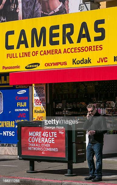 A man talks on a cell phone outside a Fisherman's Wharf camera store on April 15 in San Francisco California Some 136 million international travelers...