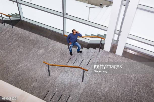 A man talks on a mobile device at the MaRS Discovery District building in Toronto Ontario Canada on Tuesday March 14 2017 The MaRS Discovery District...