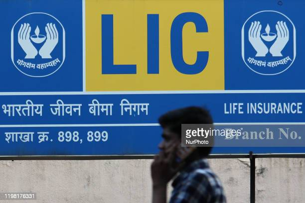A man talks on a mobile phone outside the Life Insurance Corporation of India branch in Mumbai India on 02 February 2020