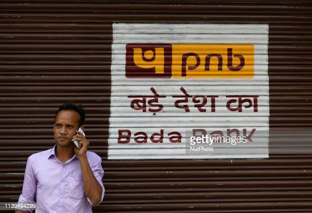 A man talks on a phone in front of PNB in Kolkata India on 27 April 2019 Punjab National Bank has appointed Rajesh Kumar Yaduvanshi as the executive...