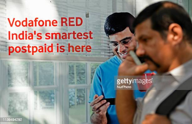 Man talks on a phone in Kolkata, India on 26 April, 2019. Vodafone Idea rights issue subscribed 1.07 times according to data accessed by merchant...