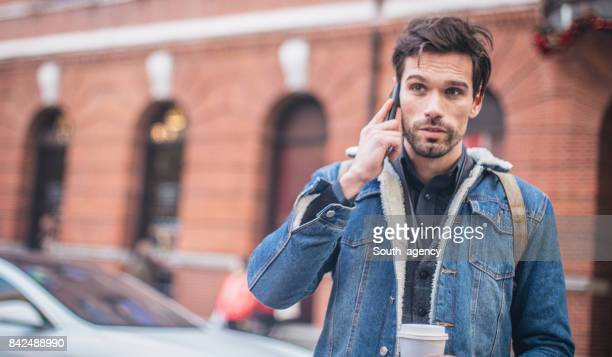 Man talks on cell phone