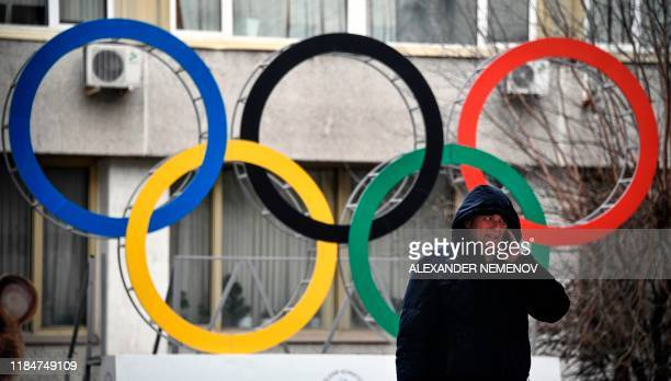 A man talks on his mobile phone in front of the Russian Olympic Committee headquarters in Moscow on November 26 2019 Russia's antidoping chief said...