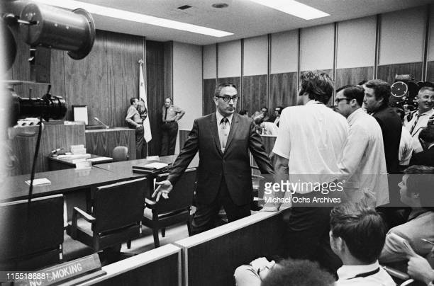 Man talks to reporters attending a hearing regarding the murder of music teacher Gary Hinman by members of the Manson Family at the Santa Monica...