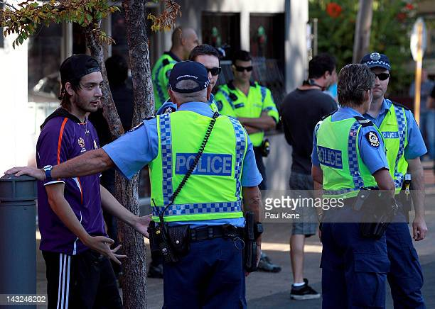 A man talks with a police officer after trouble broke out between fans at the Elephant and Wheelbarrow pub after the ALeague Grand Final between the...