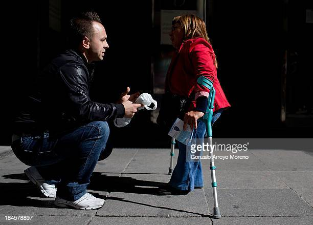 A man talks with a Thalidomide victim outside the court after the first day of a trial involving the German pharmaceutical company Gruenenthal which...
