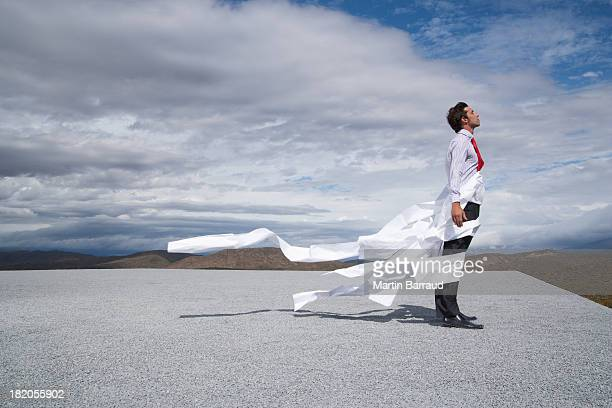 man tangled in wind blown papers - restraining stock photos and pictures