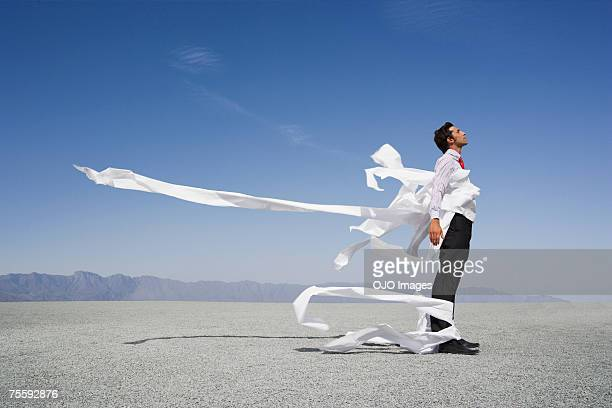 Man tangled in wind blown papers
