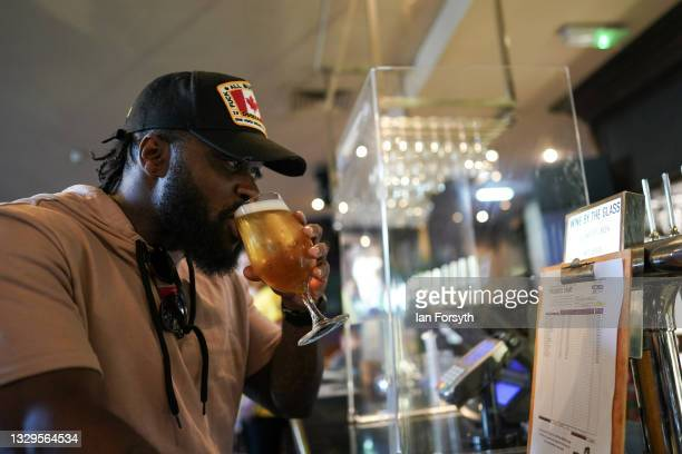 Man tastes his drink at the bar in the Mile Castle pub on Freedom Day on July 19, 2021 in Newcastle upon Tyne, England. As of 12:01 on Monday, July...