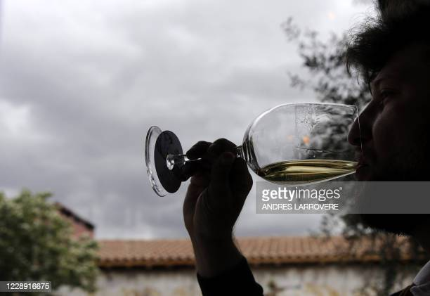 Man tastes wine at Argentinian agronomist and winemaker Alejandro Vigil's Casa Vigil winery, restaurant and art space, in Chachingo, Maipu...