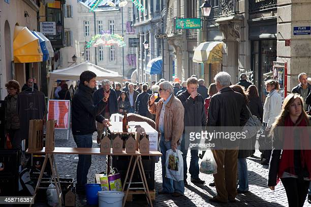 man tasting artisanal beer at open air stand - lausanne stock photos and pictures