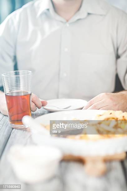 Man tasting classical quiche