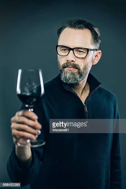 Man tasting red wine