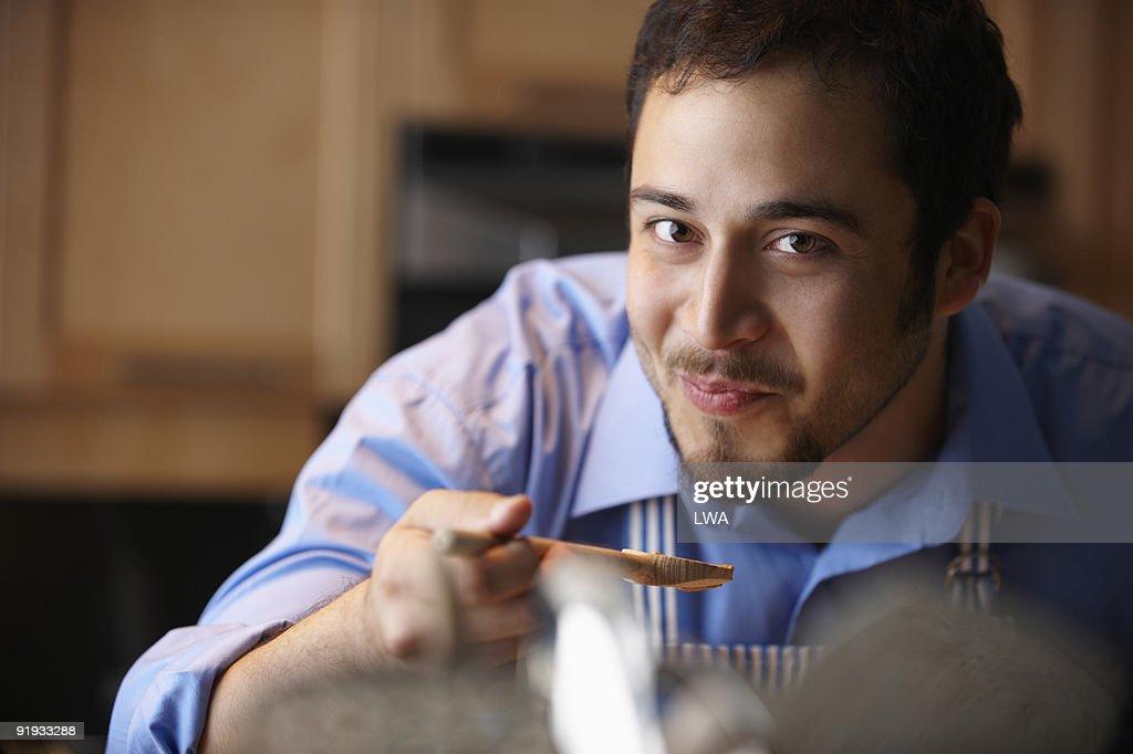 Man Tasting Sauce, In Kitchen : Stock Photo