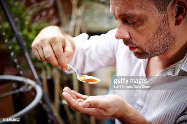 Man Tasting Sauce