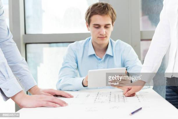 man technicians team discussing sketch in modern office